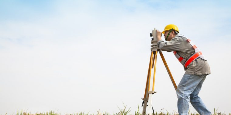 Photo: Surveyor Engineer Making Measure On The Field